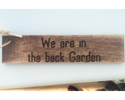 We are in the back garden sign